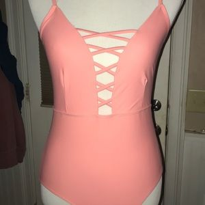 Light pink bathing suit with crisscross top